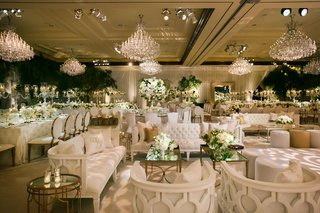 wedding-reception-lounge-area-chandeliers-mirror-coffee-table-settee-sofa-armchair-forest