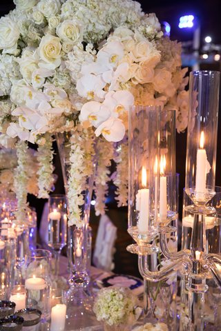 wedding-reception-centerpiece-white-orchid-white-rose-white-cascading-flowers-candlelight-floating