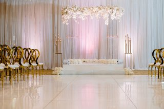 modern-wedding-ceremony-gold-chairs-acrylic-lucite-arch-white-rose-hydrangea-orchid-flowers