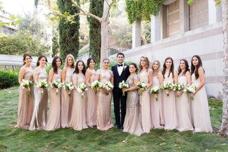 groom-in-tuxedo-with-bridesmaids-in-mismatched-champagne-dresses-with-white-bouquets