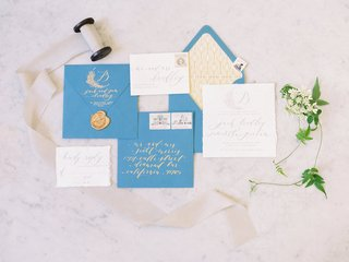 seniman-calligraphy-wedding-invitation-suite-with-blue-envelopes-gold-lining-seal-calligraphy