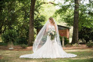 bride-in-mermaid-lace-dress-with-billowing-cathedral-veil