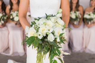 bridal-bouquet-white-flowers-and-greenery-bridesmaids-in-back