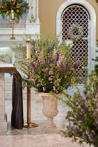 church-wedding-with-floral-display-of-purple-flowers-and-greenery