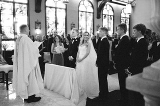black-and-white-photo-of-bride-and-groom-at-ceremony-in-palm-beach-catholic-wedding