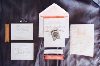 white-invitation-suite-with-peach-accents