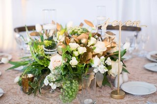 demarco-murray-wedding-centerpiece-with-gold-leaves-laser-cut-table-number
