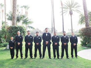 wedding-of-levine-toilolo-nfl-player-with-groomsmen-in-black-suits-ties-tropical-setting-california