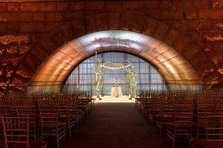 wedding-ceremony-granite-arch-at-new-york-city-venue-unique-architecture-under-bridge
