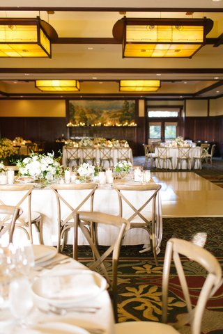 the-lodge-at-torrey-pines-wedding-reception-ballroom-neutral-decor-wood-chairs-white-linens-greenery