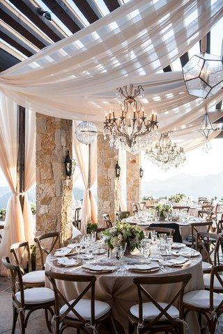 malibu-rocky-oaks-vineyard-wedding-reception-round-tables-chandeliers-geometric-orbs-drapery-wood