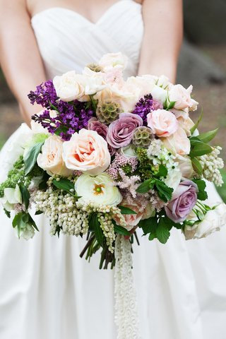 brides-bouquet-for-outdoor-wedding-with-pink-and-purple-roses-white-and-purple-flowers-greenery