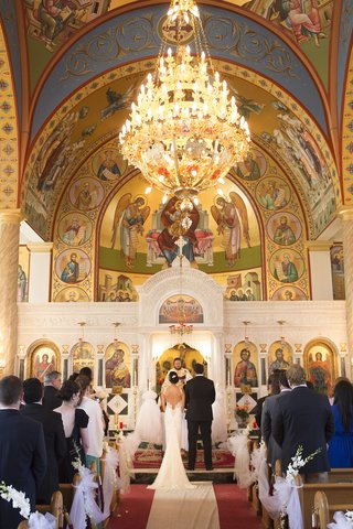 bride-in-inbal-dror-dress-and-groom-in-tuxedo-at-altar-of-ascension-greek-orthodox-church