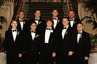 groom-and-groomsmen-in-tuxedos-with-colorful-calla-lily-boutonnieres