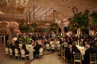 the-breakers-wedding-reception-with-guests-in-ballroom-full-of-greenery