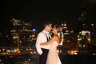 wedding portrait bride in strapless wedding dress low ponytail groom in shirt and untied bow tie