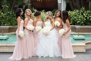 bride-in-reem-acra-ball-gown-bridesmaids-in-blush-amsale-dresses