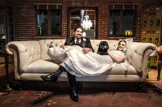 hector-maldonado-bassist-from-train-in-tommy-hilfiger-bride-in-oscar-de-la-renta-on-couch-dachshund
