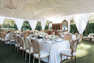 white-tent-with-chandelier-and-rustic-elegant-wedding-decorations