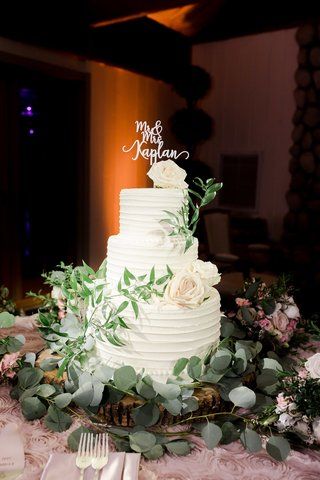 classic-wedding-cake-with-ivory-roses-and-greenery