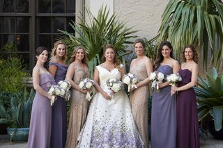 bride-in-purple-floral-romona-keveza-wedding-dress-bridesmaids-in-mismatched-purple-and-champagne
