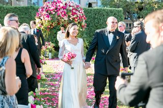 vow-renewal-30-anniversary-party-ceremony-recessional-hand-in-hand-black-double-breasted-tuxedo