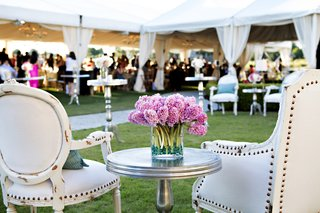 pink-flower-arrangement-at-outdoor-wedding-lounge-area