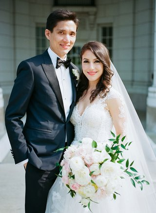 wedding-portrait-groom-in-tuxedo-and-bow-tie-bride-in-monique-lhuillier-wedding-dress-and-veil-hair