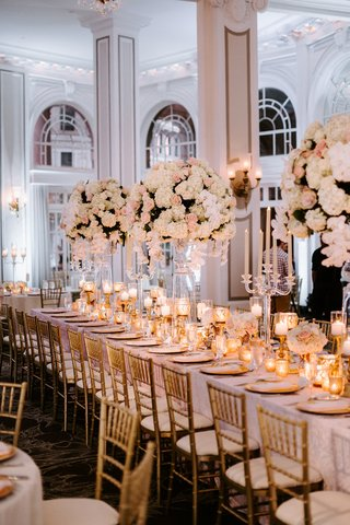 tall-ceiling-high-ballroom-white-pink-centerpiece-flowers-gold-chairs-chargers-candles