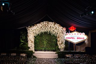 wedding-ceremony-white-chuppah-greenery-hedge-wall-vow-renewal-surprise-chapel-of-the-bells-vegas