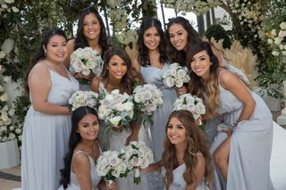 bride-with-bridesmaids-in-silver-grey-gowns-muted-bouquet-long-hair-loose-curls-pampas-grass-decor