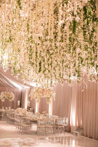 wedding-reception-cascading-flowers-and-greenery-over-white-dance-floor-tent-wedding-reception
