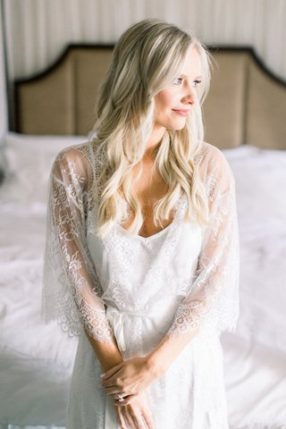bride-with-long-blonde-hair-curls-pink-manicure-in-sheer-white-robe-lace-pretty