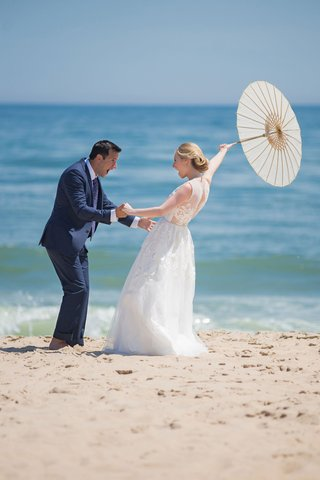 wedding-portrait-bride-groom-reaction-first-look-parasol-beach-montauk-east-coast-new-york