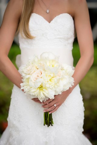 bridal-bouquet-of-white-roses-white-peonies-and-dahlias-with-a-bit-of-yellow-and-pink-color
