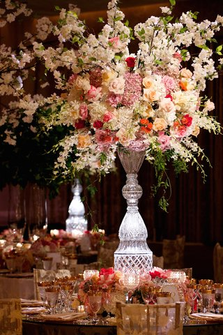 crystal-vase-overflowing-with-roses-and-hydrangeas