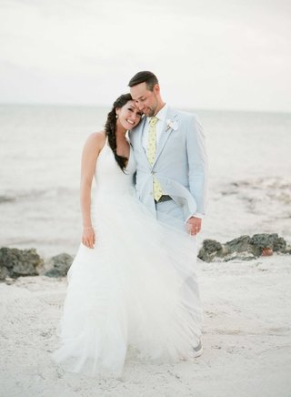 destination-wedding-beach-bride-halter-dress-with-tulle-skirt-vera-wang-and-groom-in-light-suit