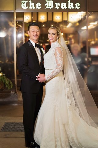 rob-refsnyder-of-new-york-yankees-and-bride-in-matthew-christopher-gown-outside-the-drake-hotel