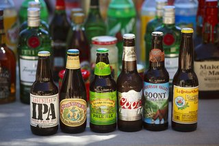 bottles-of-different-beers-and-ales-at-outdoor-wedding-reception