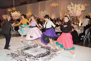 sock-hop-entertainment-on-custom-dance-floor-with-monogram-in-center-singers-and-dancers-in-poodle