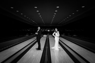 black-and-white-photo-of-bride-and-groom-portrait-in-bowling-alley-on-lanes-unique-wedding-pic-idea