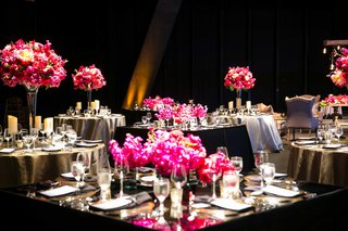 small-square-and-circular-tables-with-black-and-grey-linens-tall-low-bright-pink-florals-dark-space