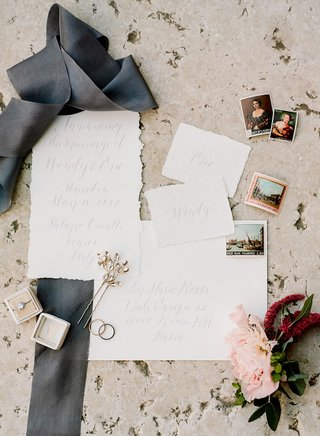 wedding-ring-in-velvet-box-with-flowers-postage-stamps-ripped-paper-raw-edge-invitation-calligraphy