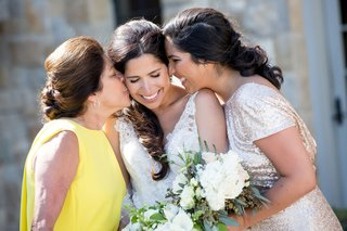 bride-in-monique-lhuillier-wedding-dress-with-mother-of-bride-in-yellow-dress-updo-and-sister