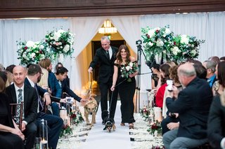 wedding-ceremony-at-vibiana-drapery-green-flower-arrangements-dogs-with-flower-collars-ring-bearer