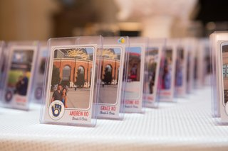 wedding-reception-with-personalized-place-cards-in-the-form-of-baseball-cards-with-photos-of-couple