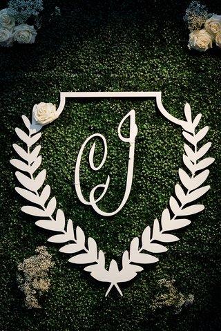 wedding-reception-greenery-hedge-wall-laurel-wreath-monogram-white-flowers-seating-chart-welcome