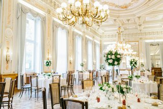classic-wedding-color-palette-for-villa-ballroom-reception-chandelier-candelabra-cane-back-chairs