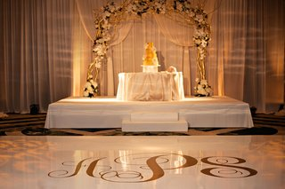 white-and-gold-dance-floor-and-cake-stage