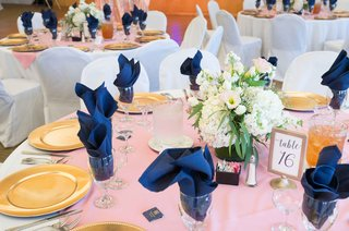 simple-pink-blue-gold-tablescape-low-florals-table-number-white-chair-covers-california-wedding